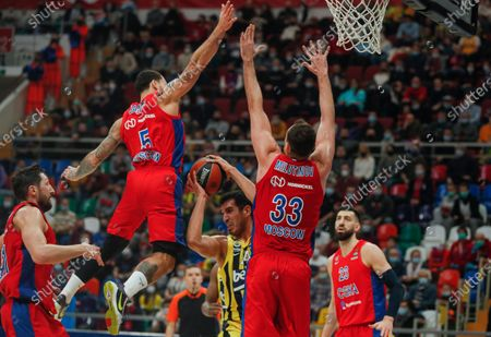 Nikita Kurbanov (L), Mike James (2nd-L), Nikola Milutinov (2nd-R) and Tornike Shengelia (R) of CSKA Moscow in action against Lorenzo Brown (C) of Fenerbahce Beko Istanbul during the Euroleague Basketball match between CSKA Moscow and Fenerbahce Beko Istanbul in Moscow, Russia, 22 January 2021.