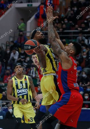 Joel Bolomboy (R) of CSKA Moscow in action against Jarell Eddie (L) and Lorenzo Brown (C) of Fenerbahce Beko Istanbul during the Euroleague Basketball match between CSKA Moscow and Fenerbahce Beko Istanbul in Moscow, Russia, 22 January 2021.
