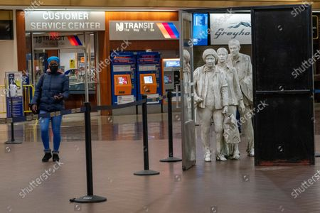 """Passenger walks past the George Segal's """"The Commuters"""" sculpture on display in the main terminal of Port Authority Bus Terminal, in New York. The Port Authority of New York and New Jersey unveiled a proposal Thursday, Jan. 21, to rebuild and expand the embattled midtown Manhattan bus terminal"""