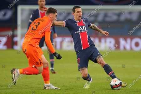 PSG's Angel Di Maria, right, is challenged by Montpellier's Joris Chotard during the French League One soccer match between Paris Saint-Germain and Montpellier at the Parc des Princes stadium in Paris, France, Friday, Jan.22, 2021