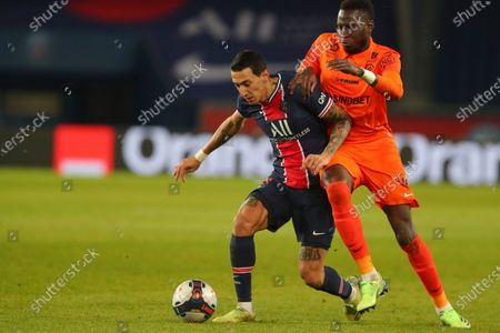 PSG's Angel Di Maria is challenged by Montpellier's Junior Sambia, right, during the French League One soccer match between Paris Saint-Germain and Montpellier at the Parc des Princes stadium in Paris, France, Friday, Jan.22, 2021