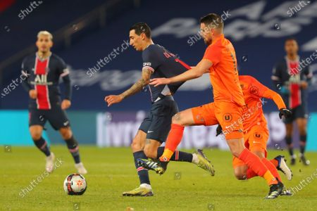 PSG's Angel Di Maria, center, is challenged by Montpellier's Damien Le Tallec during the French League One soccer match between Paris Saint-Germain and Montpellier at the Parc des Princes stadium in Paris, France, Friday, Jan.22, 2021