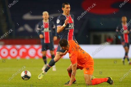 PSG's Angel Di Maria, rear, vie for the ball with Montpellier's Daniel Congre during the French League One soccer match between Paris Saint-Germain and Montpellier at the Parc des Princes stadium in Paris, France, Friday, Jan.22, 2021
