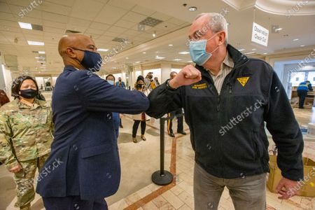 New Jersey Governor Phil Murphy, right, elbow bumps Dennis W. Pullin, President and CEO of Virtua, Froday, in Moorestown, N.J. Murphy toured the Burlington County COVID-19 Vaccination Mega-Site located inside the former Lord and Taylor department store at Moorestown Mall on Friday morning