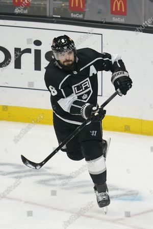 Los Angeles Kings defenseman Drew Doughty (8) passes the puck during the third period of an NHL hockey game against the Colorado Avalanche, in Los Angeles