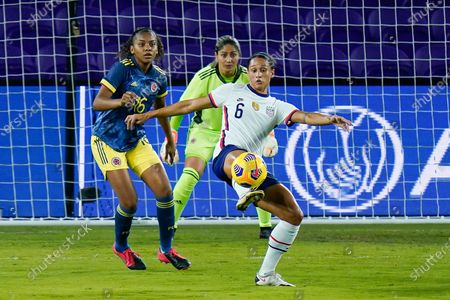 United States forward Lynn Williams (6) looks to move the ball in position for a shot on gaol against Colombia defender Jorelyn Carabali (16) and goalkeeper Sandra Sepulveda, center, during the first half of an international friendly soccer match, in Orlando, Fla