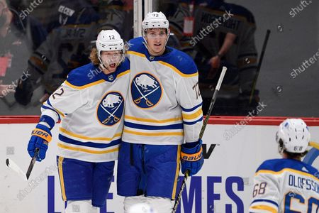 Stock Photo of Buffalo Sabres center Eric Staal (12) celebrates his goal with right wing Tage Thompson (72) and left wing Victor Olofsson (68) during the first period of an NHL hockey game against the Washington Capitals, in Washington