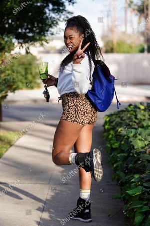 Stock Photo of Ariane Andrew out and about in cheetah print shorts