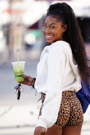 Stock Picture of Ariane Andrew out and about in cheetah print shorts