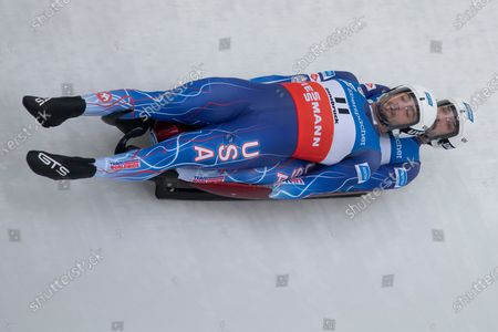 Chris Mazdzer and Jayson Terdiman of the United States speed down the track during a men's doubles race at the Luge World Cup event in Innsbruck, Austria