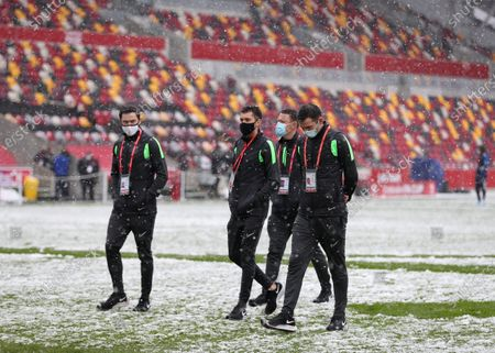 Referee Chris Kavanagh and his assistants inspect the pitch before kick off; Brentford Community Stadium, London, England; English FA Cup Football, Brentford FC versus Leicester City.