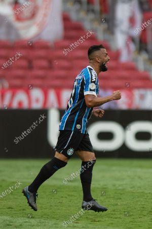 Stock Image of Maicon of Gremio celebrates scored goal by Jean Pyerre in the 76th minute 0-1; Beira-Rio Stadium, Porto Alegre, Brazil; Brazilian Serie A, Internacional versus Gremio.