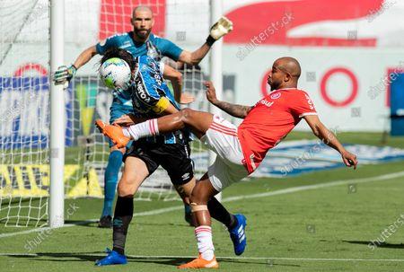 Patrick of Internacional and Pedro Geromel of Gremio; Beira-Rio Stadium, Porto Alegre, Brazil; Brazilian Serie A, Internacional versus Gremio.