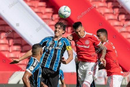 Víctor Cuesta of Internacional and Pedro Geromel of Gremio; Beira-Rio Stadium, Porto Alegre, Brazil; Brazilian Serie A, Internacional versus Gremio.