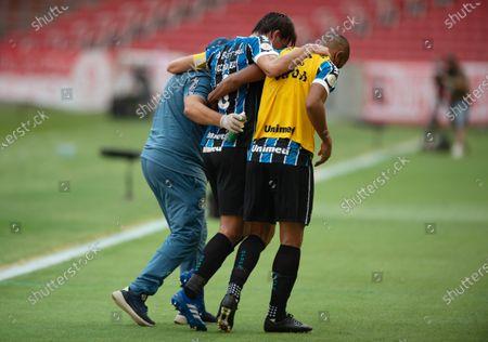 Pedro Geromel of Gremio leaves the pitch after feeling injury; Beira-Rio Stadium, Porto Alegre, Brazil; Brazilian Serie A, Internacional versus Gremio.