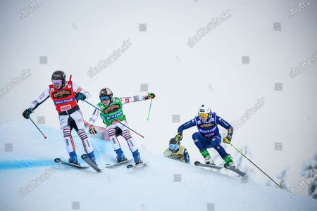 (L-R) Francois Place of France and compatriots Jean Frederic Chapuis and Simone Deromedis in action during the men's 1/8th final heat 3 during the men's Ski Cross final at the FIS Freestyle Ski World Cup event in Idre, Sweden