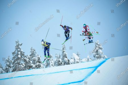 Stock Photo of (L-R) Simone Deromedis of Italy,, Christopher Delbosco of Canada, Johannes Rohrweck of Austria and Jean Frederic Chapuis of France in action during the men's quarterfinal heat 2 during the men's Ski Cross final at the FIS Freestyle Ski World Cup event in Idre, Sweden