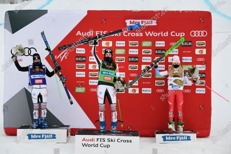 Alizee Baron (green, center) of France wins, Marielle Berger Sabbatel (blue, left) placed second and Fanny Smith (right) placed third in the woman's big Ski Cross final at the FIS Freestyle Ski World Cup event in Idre, Sweden