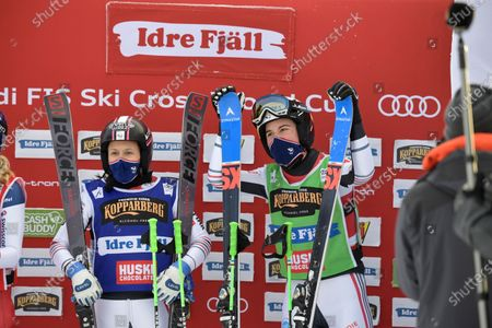Alizee Baron (green, right) of France wins and Marielle Berger Sabbatel (blue, left) place second in the woman's big Ski Cross final at the FIS Freestyle Ski World Cup event in Idre, Sweden
