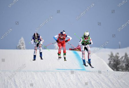 Alizee Baron (green, right) of France wins, Marielle Berger Sabbatel (blue, left) place second and Fanny Smith (red) of Switzerland place third in the woman's big Ski Cross final at the FIS Freestyle Ski World Cup event in Idre, Sweden 23 January 2021.