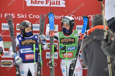 Stock Image of Alizee Baron (green, right) of France wins and Marielle Berger Sabbatel (blue, left) placed second in the woman's big Ski Cross final at the FIS Freestyle Ski World Cup event in Idre, Sweden 23 January 2021.