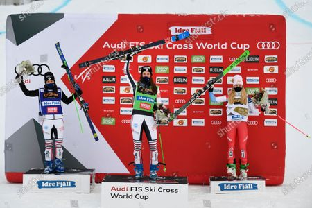 Stock Photo of Alizee Baron (green, center) of France wins, Marielle Berger Sabbatel (blue, left) placed second and Fanny Smith (right) placed third in the woman's big Ski Cross final at the FIS Freestyle Ski World Cup event in Idre, Sweden 23 January 2021.