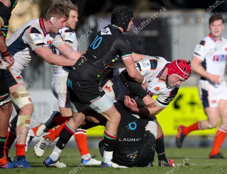 Grant Gilchrist - Edinburgh lock is tackled by Zebre fly half Carlo Canna.