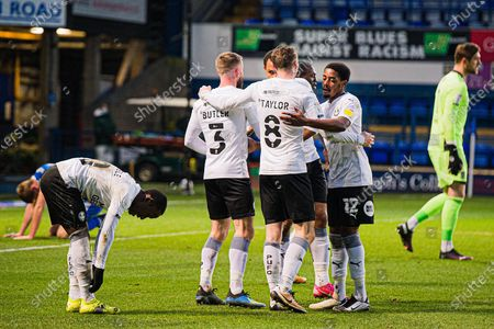 GOAL 0-1 Peterborough Utd Defender Dan Butler (3), Peterborough Utd Midfielder Jack Taylor (8), Peterborough Utd Midfielder Reece Brown (12) Peterborough Utd Midfielder Siriki Dembele (10) celebrate get the only goal of the game after an own goal from Ipswich Town defender Mark McGuiness (2) during the EFL Sky Bet League 1 match between Ipswich Town and Peterborough United at Portman Road, Ipswich