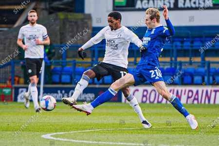 Peterborough Utd Midfielder Reece Brown (12) and Ipswich Town midfielder Flynn Downes (21) battle for the ball during the EFL Sky Bet League 1 match between Ipswich Town and Peterborough United at Portman Road, Ipswich