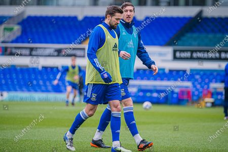 Ipswich Town defender Stephen Ward (3) and Ipswich Town midfielder Gwion Edwards (7) discuss pre match tactics during the warm ups before the EFL Sky Bet League 1 match between Ipswich Town and Peterborough United at Portman Road, Ipswich