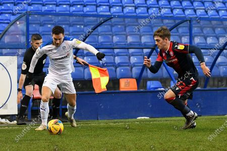 Tranmere Rovers midfielder Kieron Morris in possession against Bolton Wanderers midfielder Ben Jackson during the EFL Sky Bet League 2 match between Tranmere Rovers and Bolton Wanderers at Prenton Park, Birkenhead