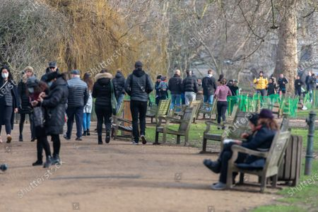 Members of the public enjoy a walk in the winter sunshine in St James's Park, London today. Yesterday, Prime Minister Boris Johnson revealed that the new UK Covid-19 mutation B.1.1.7 could be 30 per cent more deadly than the previous ones as senior NHS doctors want the gap between doses halved to six weeks rather than the current 12 weeks.