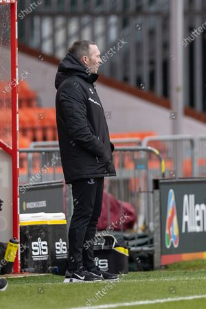 Stock Picture of Northampton Town manager Keith Kurle during the EFL Sky Bet League 1 match between Lincoln City and Northampton Town at Sincil Bank, Lincoln
