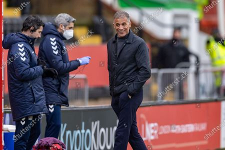 Northampton Town manager Keith Kurle smiles during the EFL Sky Bet League 1 match between Lincoln City and Northampton Town at Sincil Bank, Lincoln