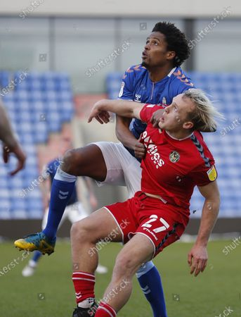 Stock Image of Jack Scrimshaw tussle with Cameron Borthwick-Jackson of Oldham Athletic