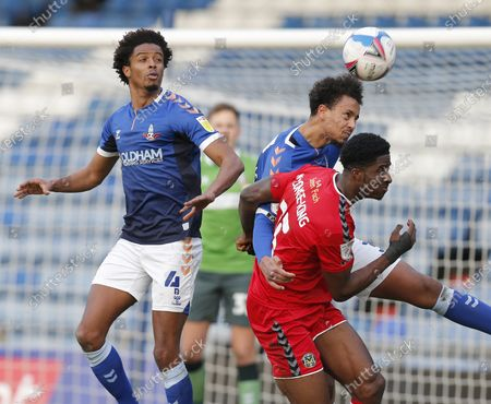Cameron Borthwick-Jackson of Oldham Athletic and Sido Jombati of Oldham Athletic take away the chance of a goal from David Longe-King of Newport County