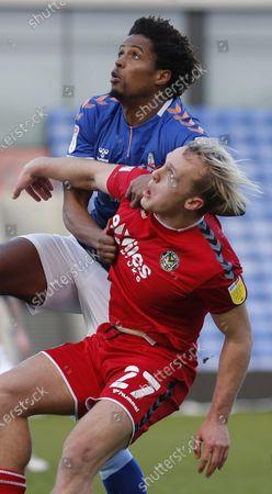 Jack Scrimshaw tussle with Cameron Borthwick-Jackson of Oldham Athletic