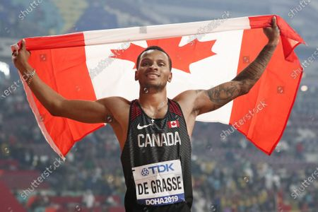 Andre de Grasse, of Canada, celebrates after winning the silver medal in the men's 200 meters at the World Athletics Championships in Doha, Qatar. When the American Track League opens its four-week-long series on de Grasse will be one of the athletes competing at the indoor setting at the University of Arkansas
