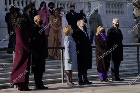 Former President Barack Obama and his wife Michelle, former President George W. Bush and his wife Laura and former President Bill Clinton and his wife former Secretary of State Hillary Clinton stand at the Tomb of the Unknown Soldier at Arlington National Cemetery during Inauguration Day ceremonies in Arlington, Va