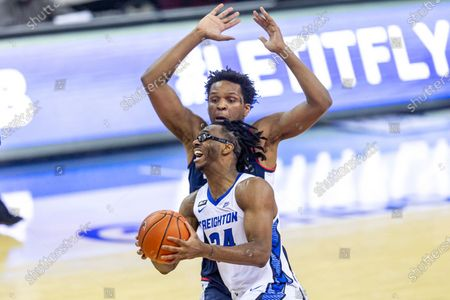 Stock Picture of Creighton guard Denzel Mahoney (34) drive to the basket against Connecticut forward Josh Carlton (25) in the second half during an NCAA college basketball game, in Omaha, Neb
