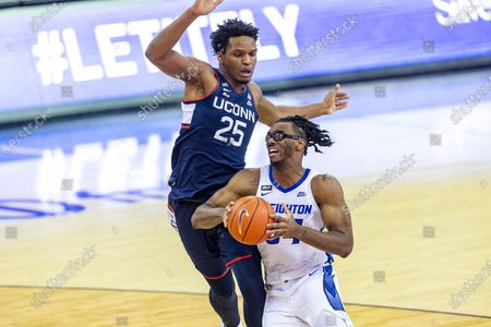Creighton guard Denzel Mahoney (34) drive to the basket against Connecticut forward Josh Carlton (25) in the second half during an NCAA college basketball game, in Omaha, Neb