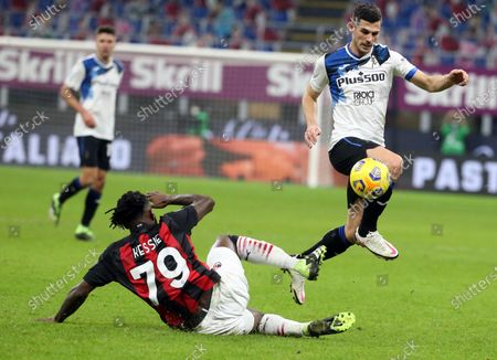 AC Milan's Franck Kessie (L) challenges for the ball  Atalanta's Remo Freuler during the Italian Serie A soccer match between AC Milan and Atalanta BC at Giuseppe Meazza stadium in Milan, Italy, 23 January 2021.