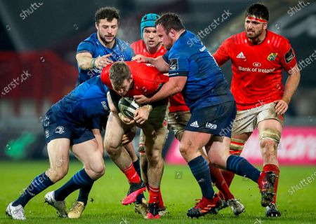 Munster vs Leinster. Munster's Chris Farrell is tackled by Robbie Henshaw and Ed Byrne of Leinster
