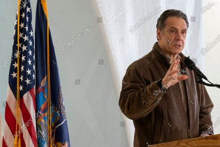 New York Gov. Andrew Cuomo speaks to reporters during a news conference at a COVID-19 pop-up vaccination site in the William Reid Apartments in the Brooklyn borough of New York