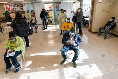 Residents of the William Reid Apartments rest for a few minutes after receiving the first dose of the COVID-19 vaccine at a pop-up vaccination site in the NYCHA housing complex, in the Brooklyn borough of New York