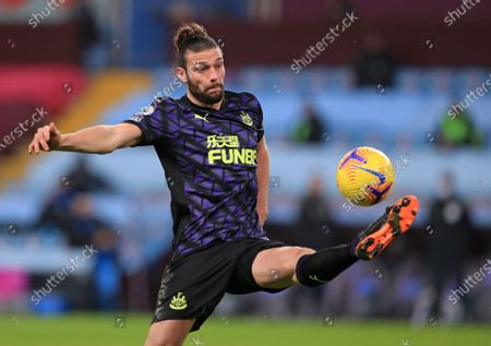 Newcastle's Andy Carroll controls the ball during the English Premier League soccer match between Aston Villa and Newcastle United at Villa Park in Birmingham, England