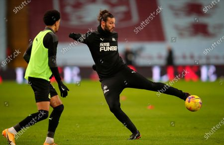 Newcastle's Andy Carroll (R) warms up for the English Premier League soccer match between Aston Villa and Newcastle United in Birmingham, Britain, 23 January 2021.