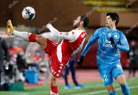 Kevin Volland (L) of AS Monaco and Hiroki Sakai (R) of Olympique Marseille in action during the French Ligue 1 soccer match AS Monaco vs Olympique Marseille, at Stade Louis II, in Monaco, 23 January 2021.