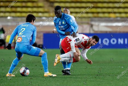 Kevin Volland (R) of AS Monaco, Hiroki Sakai (L) of Olympique Marseille and Youssouf Fofana (C) of Olympique Marseille in action during the French Ligue 1 soccer match AS Monaco vs Olympique Marseille, at Stade Louis II, in Monaco, 23 January 2021.