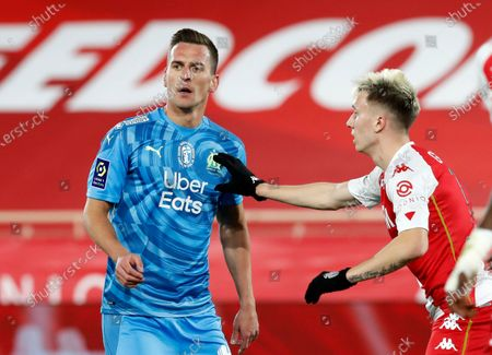 Aleksandr Golovin (R) of AS Monaco and Arkadiusz Milik (L) of Olympique Marseille in action during the French Ligue 1 soccer match AS Monaco vs Olympique Marseille, at Stade Louis II, in Monaco, 23 January 2021.